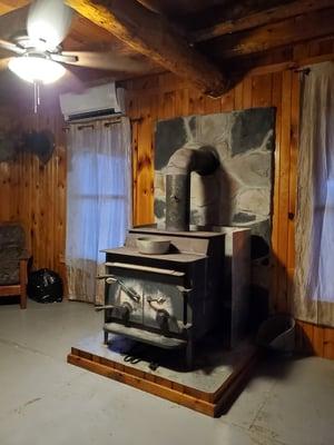 Photo of a woodstove inside Jon's hunting camp