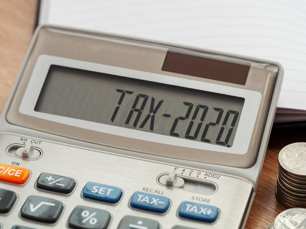 """Up close of a calculator reading """"tax-2020"""""""
